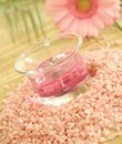 bath salt, pink candle and pink gerber Royalty Free Stock Photo