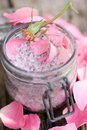 Bath salt and rose leaves Royalty Free Stock Photo