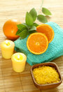Bath salt in wooden bowl, towel, candle and fresh Royalty Free Stock Photo