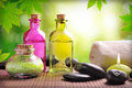 Bath salts and body oil on wood horizontal composition nature leaves bokeh background Royalty Free Stock Photography