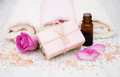 Bath towels, salt and soap with pink roses Royalty Free Stock Photo