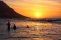 Bathers at sunset, Gordon's Bay, Cape Town Royalty Free Stock Images