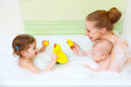 Bathing in  bath with foam mother together children baby Royalty Free Stock Photo