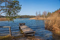 Bathing beach with boardwalk lake fohnsee osterseen bavaria and bench Royalty Free Stock Images