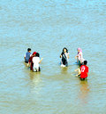 Bathing in the north sea an indian group enjoying summer sunshine at skegness lincolnshire england uk Royalty Free Stock Image