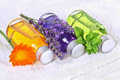 Bathing oil calendula lavender melissa and with flask on towel Stock Image