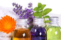 Bathing oil calendula lavender melissa and with flask and towel Stock Image