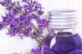 Bathing oil lavender blossoms with flask and towel Royalty Free Stock Image