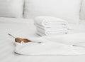 Bathrobe on the bed white Royalty Free Stock Photo