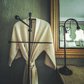 Bathrobe hanging in the room in vintage style Stock Photo
