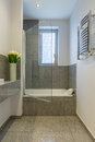 Bathroom with beige tiles Royalty Free Stock Photo