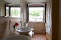 Bathroom in country house with window reflected in the mirr Royalty Free Stock Photo
