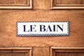 Bathroom door sign in french on a wooden Royalty Free Stock Images