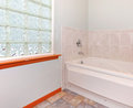 Bathroom glass block window and tub. Royalty Free Stock Photo