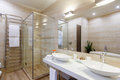 Bathroom of the hotel rooms, with a shower and a few washbasins Royalty Free Stock Photo