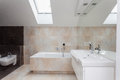 Bathroom interior with beige tiles Royalty Free Stock Photo