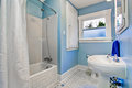Bathroom interior in light blue tones with shower bath tub