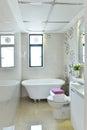Bathroom a lovely white tiled family with a large bathtub Stock Photos