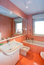 Bathroom modern with white accessories and orange tiles Stock Photos