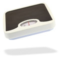 Bathroom scale jumping in the air Royalty Free Stock Photo