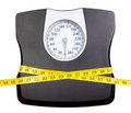 A bathroom scale with a measuring tape Royalty Free Stock Photo