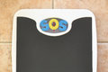 Bathroom scale with SOS text Royalty Free Stock Photo