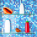 Bathroom shelves with shampoo bottles and seashells Royalty Free Stock Photos