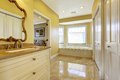 Bathroom with shiny tile floor in master bedroom Royalty Free Stock Photo
