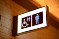 Bathroom sign for unisex handicapped and mens Royalty Free Stock Photo