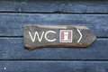 Bathroom sign on a wooden wall Royalty Free Stock Image