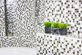 bathtub detail with stone finish and flowers Royalty Free Stock Photo