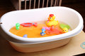 Bathtub with ducks and other toys for babies home scene Royalty Free Stock Photography