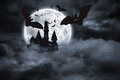 Bats flying from draculas castle Royalty Free Stock Photo