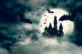 Bats flying to draculas castle Royalty Free Stock Photo