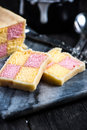 Battenberg cake on serving board Royalty Free Stock Photo