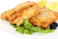 Battered fish with olives and lemon on white Royalty Free Stock Image