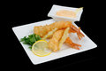 Battered shrimps three with sauce on white plate Stock Image