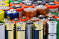 Batteries many aa sized on white Royalty Free Stock Images