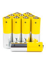 Batteries a row of yellow isolated over white background Stock Photos