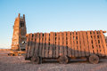 Battering ram and siege tower in a desert at evening Royalty Free Stock Photo