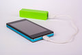 Battery power bank charging smartphone Royalty Free Stock Images