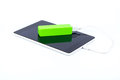 Battery power bank and tablet white charge through Stock Image