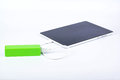 Battery power bank and tablet white charge through Royalty Free Stock Photography