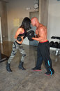 Battle of the gym sexes man and women it out in go head to head Stock Photography