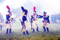 Battle scene reenactors dressed as napoleonic war soldiers fight in fume at borodino historical reenactment at its th anniversary Royalty Free Stock Images
