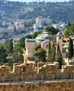 Battlements of jerusalem the morning sun illuminates the dome the church in surrounded by majestic building on the wall Stock Image