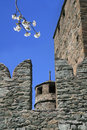 Battlements and tower in fenis castle white blossoms Stock Photos