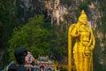 Batu Caves, gold statue Lord Murugan. Kuala Lumpur, Malaysia. Royalty Free Stock Photo