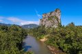 Batu melintang rock outcrop along east west gerik jeli highway he behind this is a village and right below it at the foot of the Stock Photography