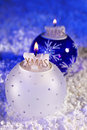 Baubles with candles, artificial snow Royalty Free Stock Photo